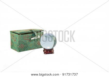 Miniature, crystal ball on wooden stand with Oriental themed case
