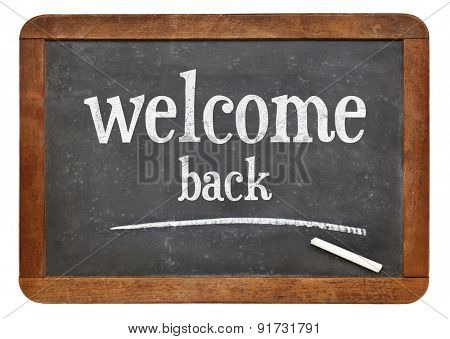 Welcome back sign - text on a vintage slate blackboard