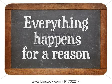 Everything  happens for a reason - text on a vintage slate blackboard