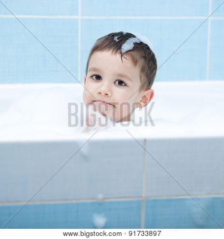 Child Bathes In A Bathroom