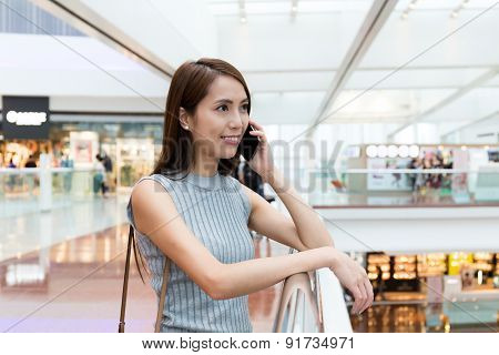 Young asian woman chat on mobile phone at shopping center
