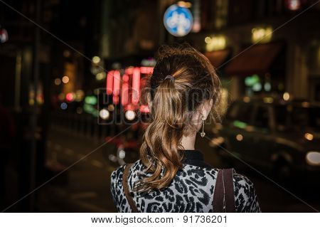 Woman Standing In The Street At Night