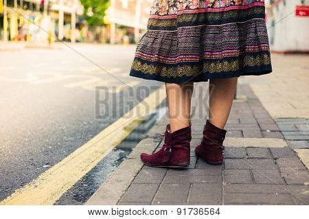 Legs Of Woman Wearing Skirt In The Street