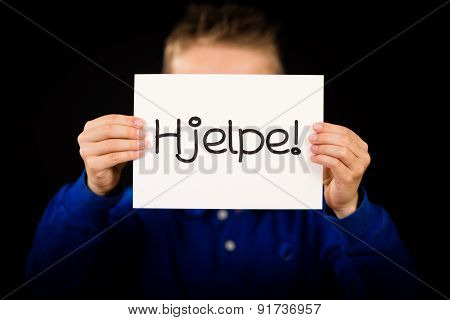 Child Holding Sign With Norwegian Word Hjelp - Help