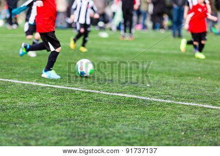 Blurred Young Kids Playing Soccer