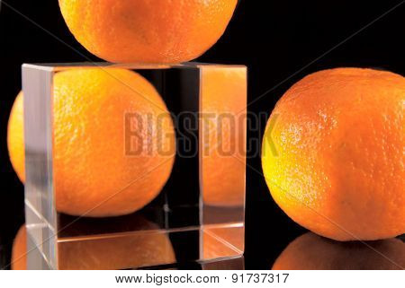 Tangerines on the black background