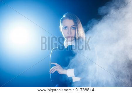 Beautiful Young Woman Behind The Cloud Of Smoke