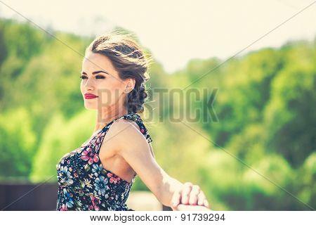 Brunette Woman On The Old Bridge In Black Dress