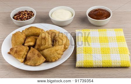 White Plate With Small Pasties, Bowls With Sauce, Spices