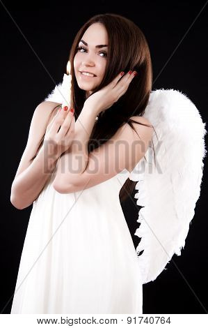 Happy Young Angel With A Candle