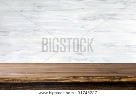 Empty wooden table with light background