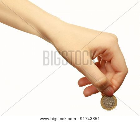 Female hand with coin isolated on white