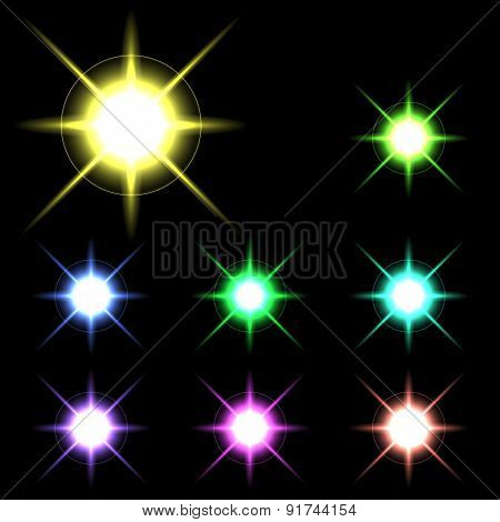 Vector glowing lights, stars and sparkles 4