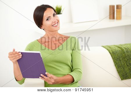 Peaceful Young Female Holding A Tablet