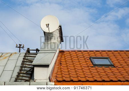 Satellite antenna on the  roof.