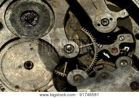 Closeup Of Cogweels In Clockwork, Grunge Background For Steampunk Engineering Design