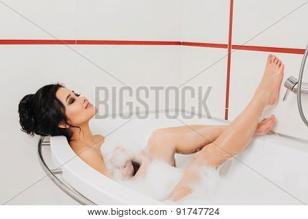 beautiful sexy girl long hair in the bath with foam