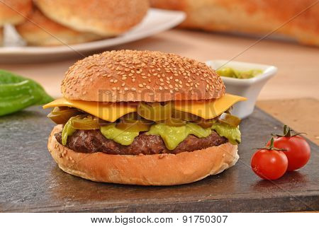 Jalapenos rustic cheese burger and avocado sauce.