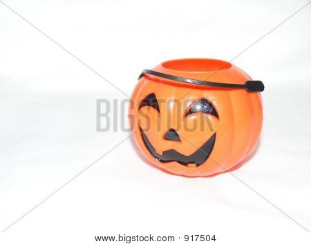 small halloween pumkin candy pail isolated on white