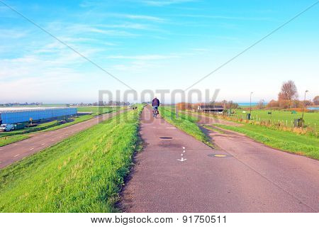 Biking on the dyke near Amsterdam in the Netherlands