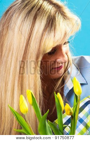 Mid Age Woman With Flowers Tulips