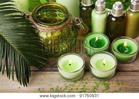 Beautiful spa composition with candles on table close up