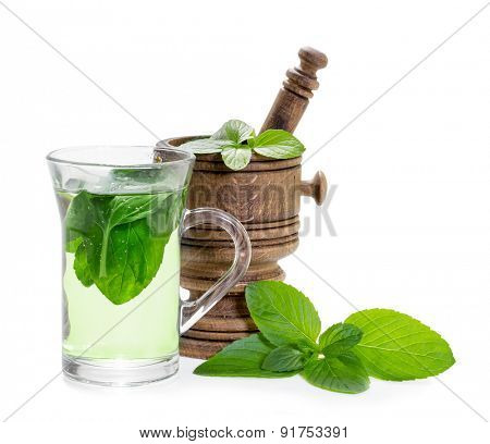 Mint tea with fresh mint leaves isolated on white background