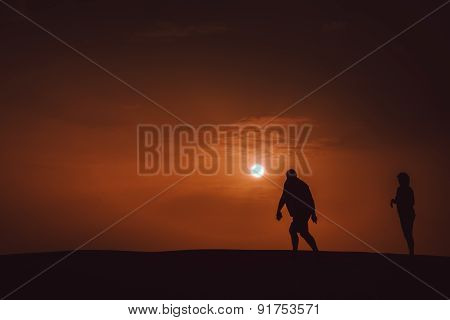 Walking on the sand dunes at dusk