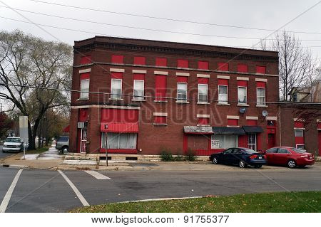 Former Commercial Building with Red Trim