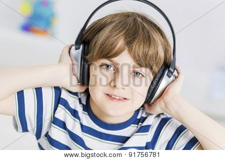 Cute boy wearing headphones and enjoying music