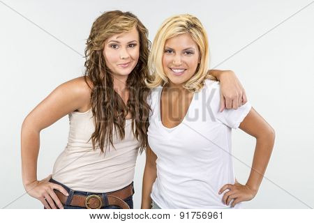 Two female friends showing affection to each other in a studio environment