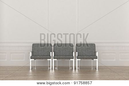Three modern metal framed armchairs in a waiting room upholstered in neutral grey and standing in a row against a wall on a parquet floor. 3d Rendering.