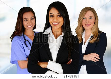 Women of all races working together in an office