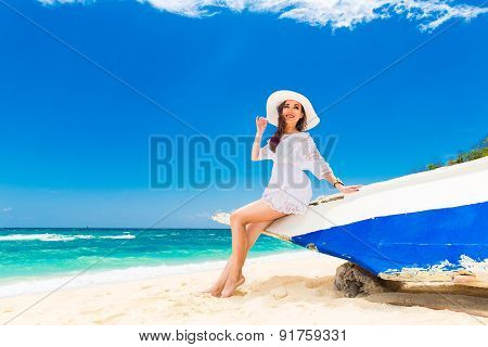 Young Beautiful Girl On The Beach Of A Tropical Island. Summer Vacation Concept.