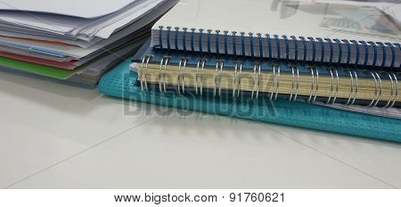 Pile Of Tax And Notepads