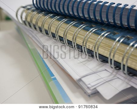 Stack Of Papers And Notebook