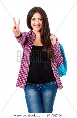 Beautiful student girl with backpack showing victory sign, isolated on white background