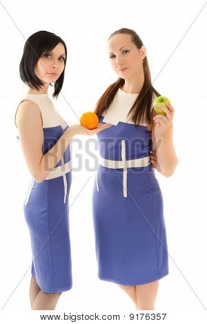 Two Beautiful Woman With Apple And Orange
