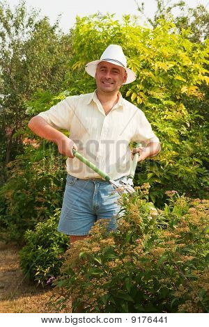 Working Man With  Garden Pruner