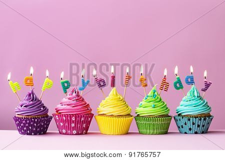 Cupcakes with candles spelling the words