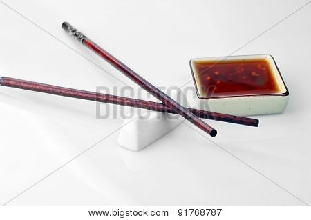 Chopsticks And Bowl With Sauce
