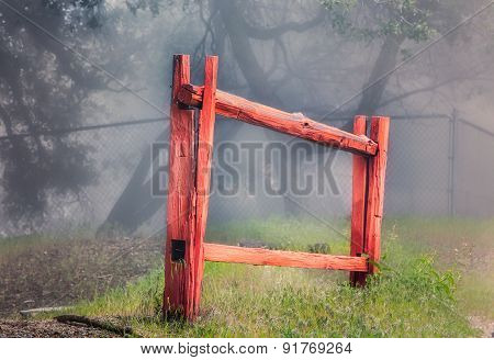 Red Stockade Fence In Forest
