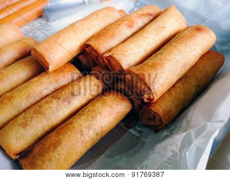 Close up of fried spring roll. Outdoor view