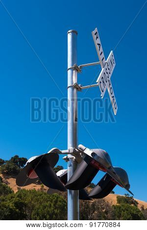 Railroad Crossing Sign With Red Lights Down