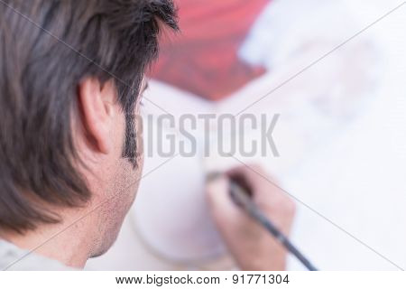 Male Painter Painting On Canvas - Painting Session.