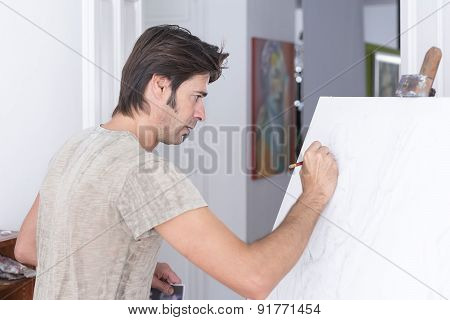 Man Drawing On Canvas - Painting Session.