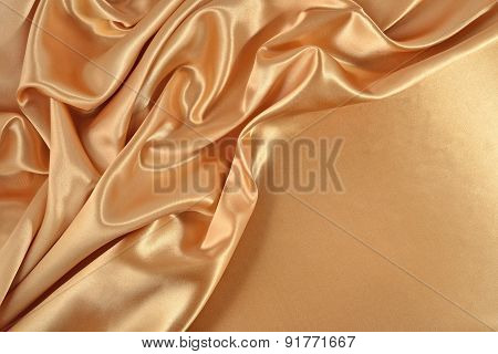Background From Golden Satin Fabric