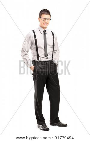 Full length portrait of a handsome young man posing in stylish clothing isolated on white background