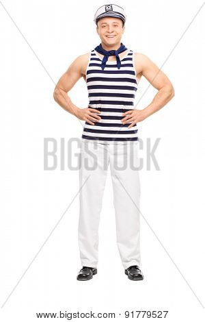 Full length portrait of a young man posing in sailor outfit smiling isolated on white background