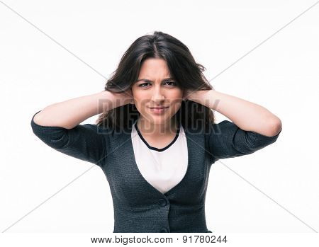 Businesswoman covering her ears with hands isolated on a white background. Looking at camera
